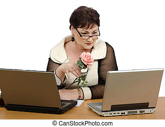 Old brunette reading news on computer