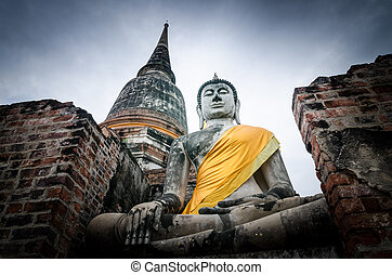 Old Buddha statue in temple at Ayutthaya, Thailand