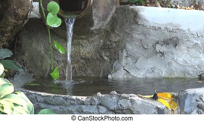 old buddhist garden fountain