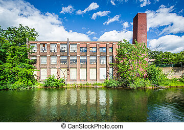 Old building along the Winnipesaukee River, in Laconia, New ...
