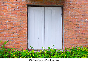 Old building brick wall with wooden window