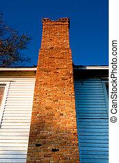 Brick chimney on old building