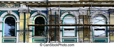 Old building under restoration. Close up. Day.