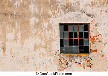 Old building with broken window in abandoned house