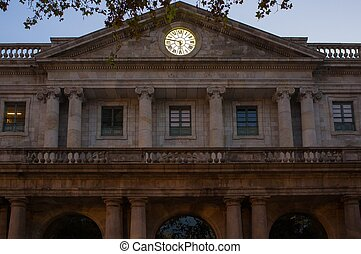 Old building with gold clock on facade