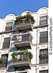 Old building with house plants on the balcony