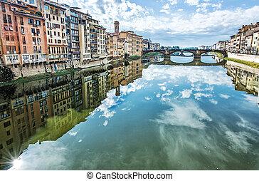 Old buildings and beautiful Ponte Santa Trinita mirrored in...