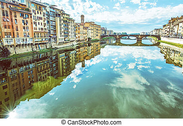 Old buildings and beautiful Ponte Santa Trinita mirrored in...