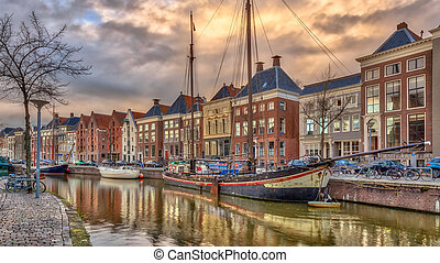 Old buildings on Hoge der Aa Quay in Groningen city centre at sunset, Netherlands
