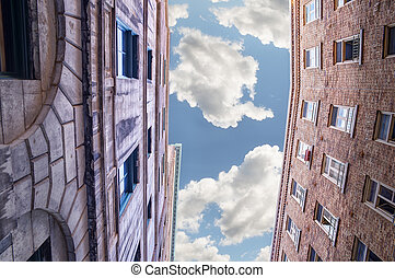Old buildings on cloudy sky background hdr effect pictures perspective and underside angle view old buildings over blue cloudy sky thecheapjerseys Image collections