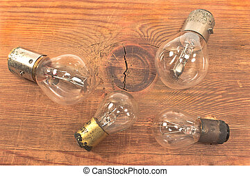 Old bulbs on wooden background