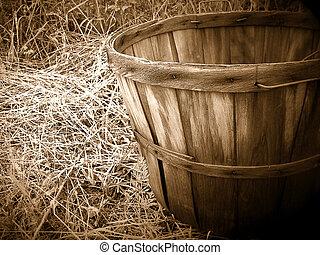 Bushel basket in a hayloft.