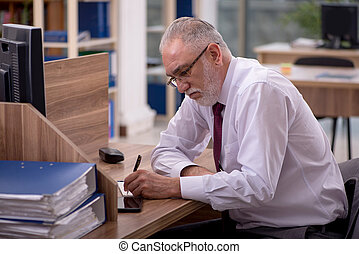 Old male employee and too much work in the office