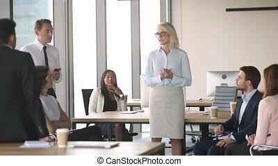 Old businesswoman leader mentor training interns employees...