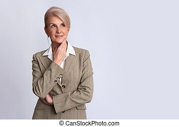old businesswoman looking up to copy space. Isolated