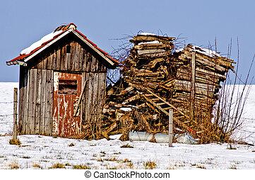 Old cabin in snow