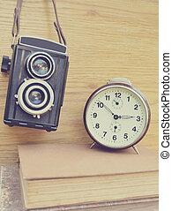 Old camera and brown clock