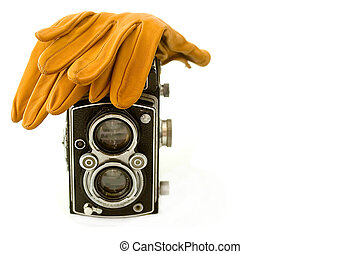 Old camera and gloves - 1940s style