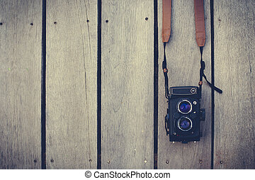 old camera - Film camera is old on wooden background. Camera...