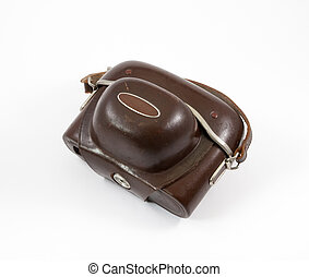Old camera in a leather case on a white background