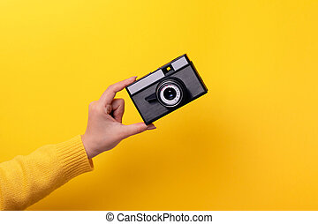 old camera in hand