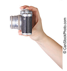 old camera in woman's hand on a white background