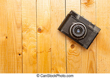old camera on a wooden background