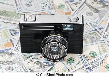 Old camera on money
