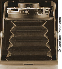 Top down view of a vintage camera - sepia with added film grain