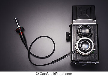old camera - twin lens reflex camera with cable release