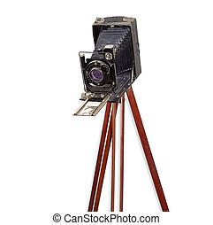 Old camera with bellows on wooden tripod on white background