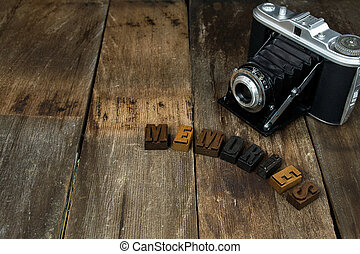 old camera with memories text