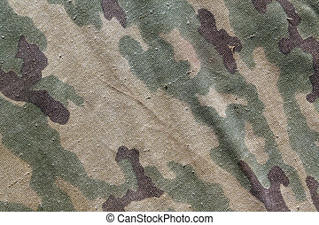 Old camouflage cloth texture. Background and texture for...