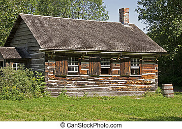 Old Canadian log house in summer