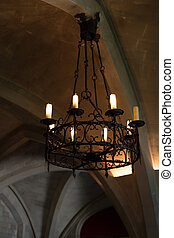 Old candelabra in vaulted roof