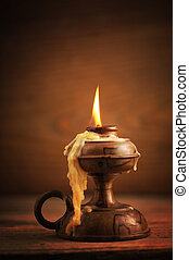 old candle on a wooden table