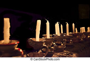 old candles in a dark church
