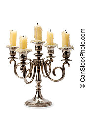 old candlestick with candles isolated on white background