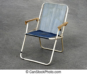 old canvas chair on the floor