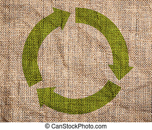 Old canvas with green recycle sign.