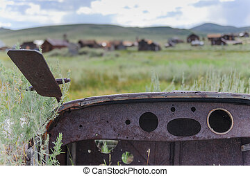 Old car abandoned in a Ghost Town - An old abandonded car is...
