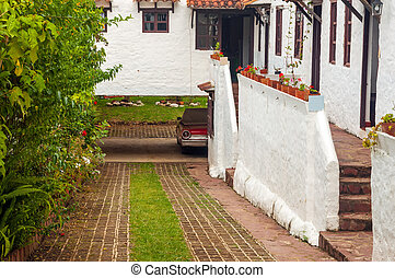 Old Car and Colonial Houses