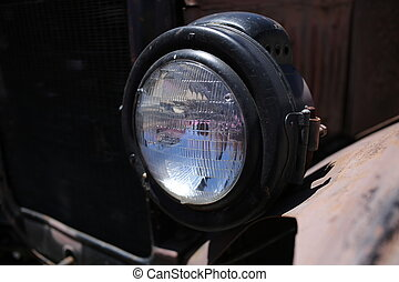 Old car headlight. Close up