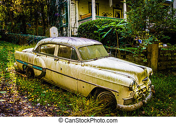 Old car in front of a house in Harpers Ferry, West Virginia....