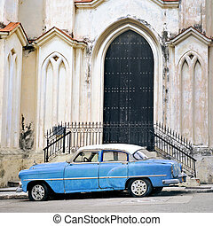 Old car in havana building facade