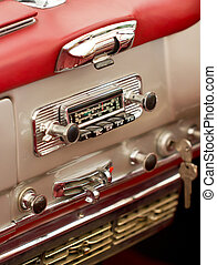 Old car radio in a classisc car.