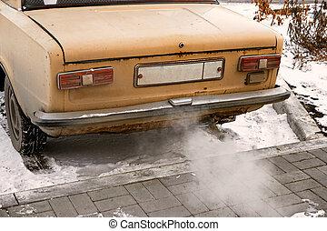 Old car smoking, environmentally dangerous vehicle