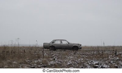 Old car thrown into the field, Side View - Screen saver with...