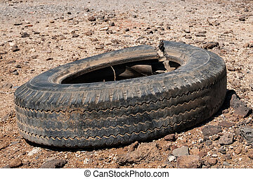 old car tire isolated in desert landscape -