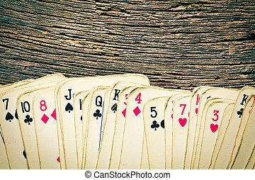 old cards on wooden table